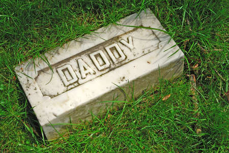 Here Lies Daddy At Rest-Memorial grave marker at historic Spring Grove Cemetery in Cincinnati Ohio USA, the second largest cemetery in the United States, established in 1845. Imagens