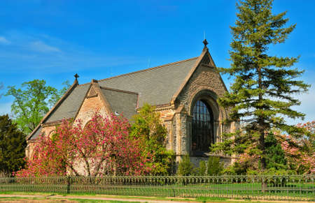 The historic Norman Chapel at Spring Grove Cemetery, Cincinnati Ohio, USA was constructed in 1880 of limestone and sandstone. It is fashioned in the Romanesque revival style and boasts several beautiful stained glass windows, pillars and arches.