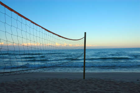 Volleyball net on the beach at Lake Michigan in August at sunrise.