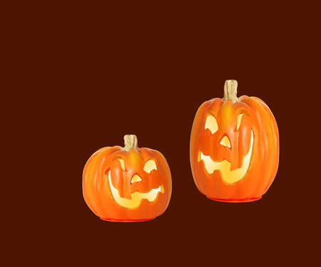 Halloween Pumpkins - A couple of smiling, carved jack o lantern pumpkins isolated with space for copy. photo