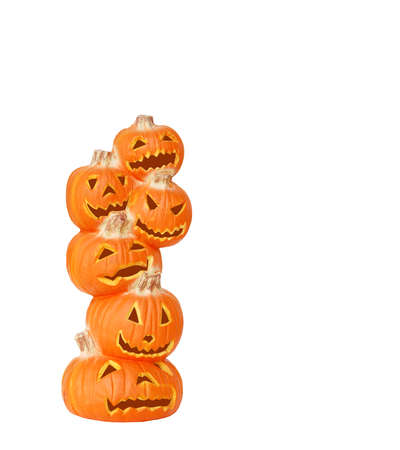 Stack of Halloween Pumpkins - A carved jack o lantern pumpkin stack isolated on white with space for copy.