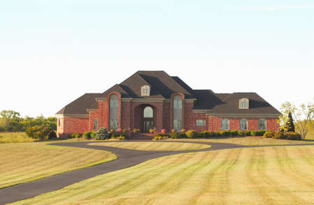 Luxury Home in the Country - a beautiful brick upscale country estate in the early morning light.