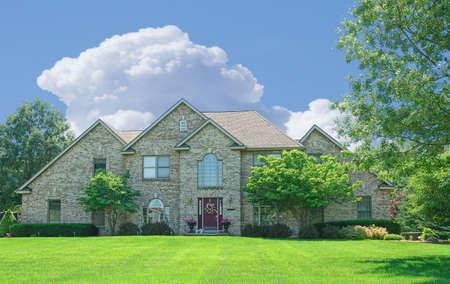 Suburban Home - A beautiful brick home in the suburbs in Michigan, USA. Stock Photo