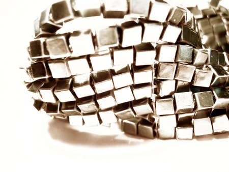 Bracelet closeup over a white background, high contrasts photo