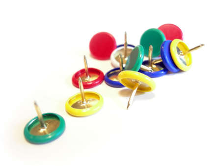 push: Closeup of a several push pins in different colors           Stock Photo
