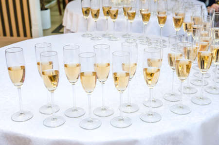 glases: Catering bar for celebration. Beauty of interior for wedding day. Champagne in the glases on the buffet table