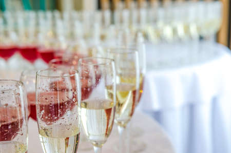 glases: Catering bar for celebration. Beauty of interior for wedding day. Champagne in the glases on the round table Stock Photo