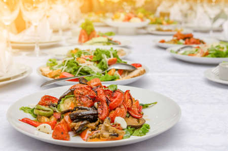 Salad with vegetable in restaurant. Decorated banquet table