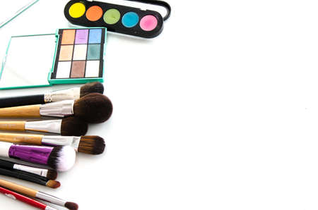 Professional makeup tools. Brush and blushes on white background. Top view with copy space