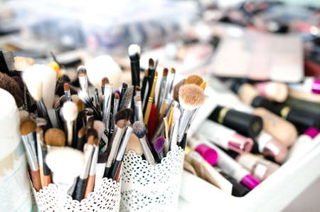 Set of makeup brushes on blurred background