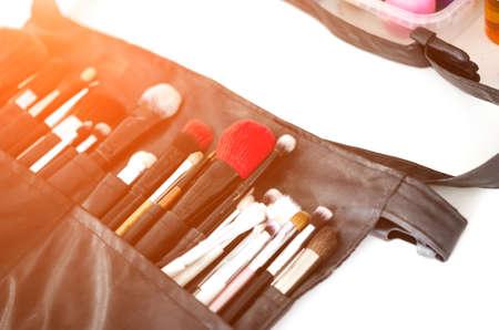 A set of brushes, powder, foundation. Makeup brush set