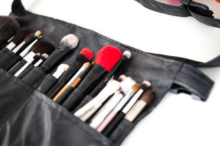 Professional makeup brush at workplace. Makeup brushes in beauty salon at workplace