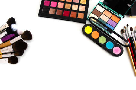 Makeup cosmetics on white background. Top view with copy space. Beauty tools palettes collection
