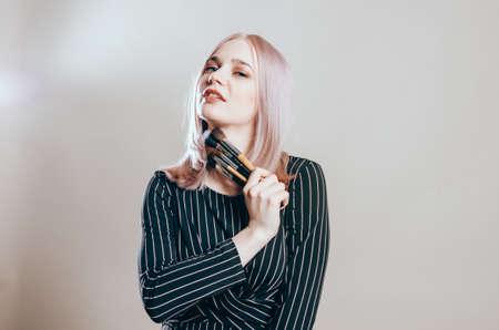 Beauty portrait of a blonde woman with natural makeup in black dress Banco de Imagens