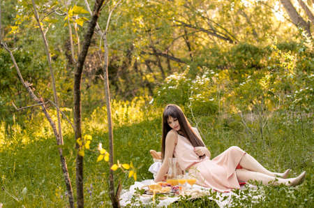 Young woman in park outside at sunny day. Beauty of nature and woman concept