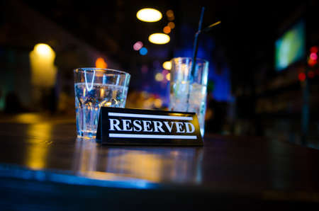 Plastic occupied sign on on bar counter
