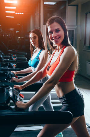 Young attractive woman doing cardio training in gym. Healthy lifestyle