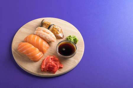 Close up of sashimi sushi set served on wooden plate. Tasty Japanese seafood