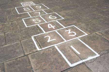 Old fashioned hopscotch childrens game drawn on a pavement