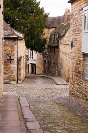 Cobbled street and stone houses in the town of Stamford, Lincolnshire, UK