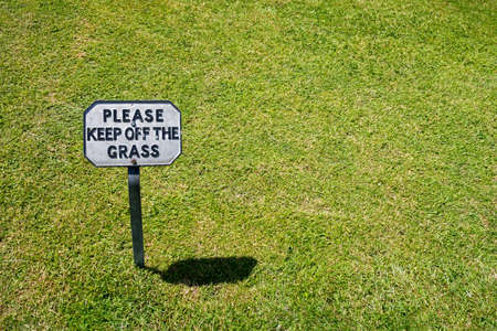 Sign saying Keep Off The Grass - copy space provided