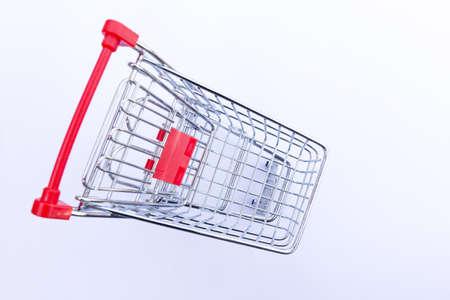 Mini empty supermarket shopping trolley on a white background Stock Photo