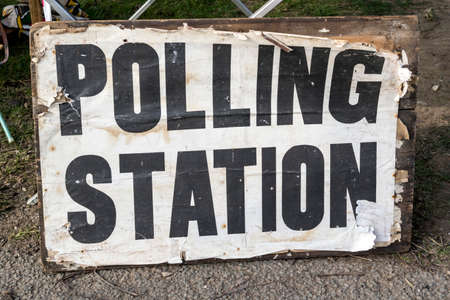 Old and tatty Polling Station sign