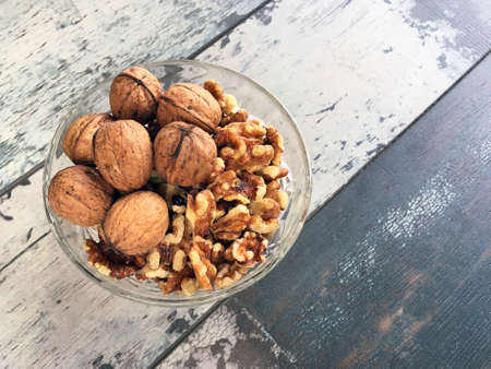 Walnuts in a glass bowl with copy space provided