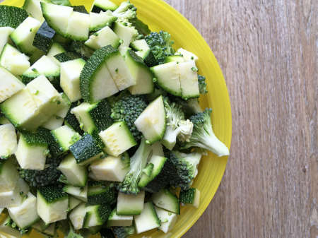 Chopped courgette and brocolli in a bowl - copy space provided