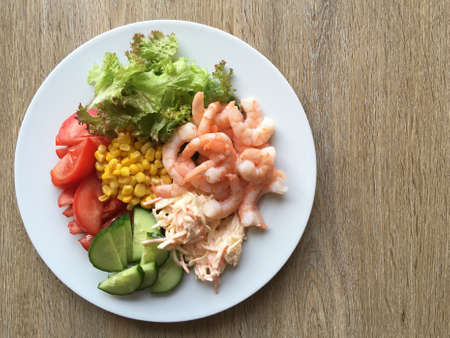 Plate of salad with prawns - copy space provided. Stock fotó