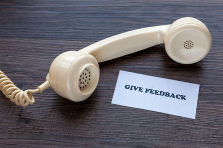 Classic telephone receiver with note - Give Feedback