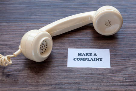 Classic telephone receiver with note - Make A Complaint