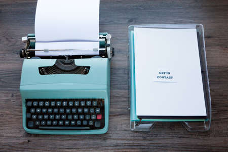 Communications Concept - Old fashioned typewriter with plastic filing tray
