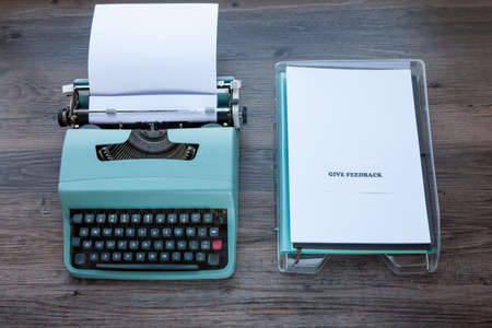 Feedback Concept - Old fashioned typewriter with plastic filing tray