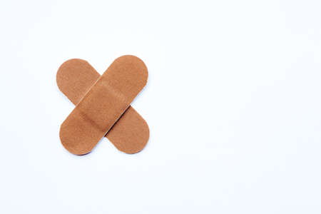 Fabric plasters in the shape of a cross