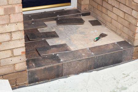 Tiling of a door threshold or doorstep