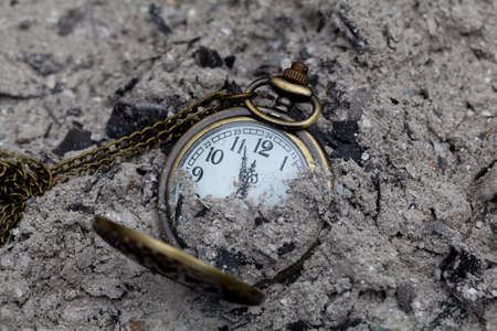 Pocket watch amongst a pile of ashes Stock fotó