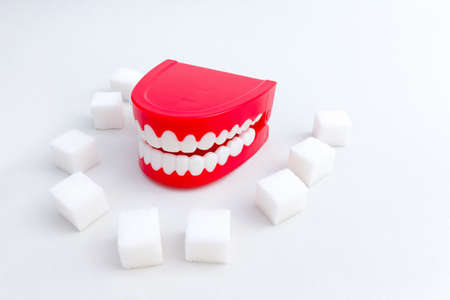 Tooth decay concept - Set of joke false teeth with sugar cubes
