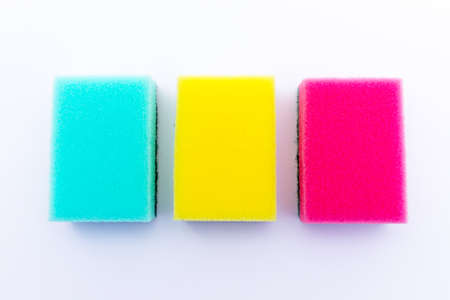 Three different coloured sponges in a row