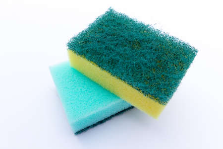 Two stacked sponges on a white background