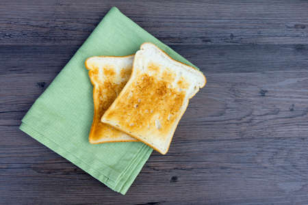 Two slices of plain unbuttered toast with a napkin