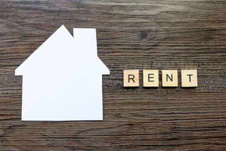 House Renting Concept - Paper house with the word Rent