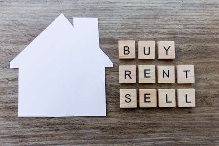 Housing Market Concept - Paper house with the words Buy, Rent, Sell