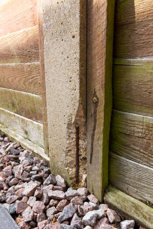 Concrete fence post with evidence of spalling