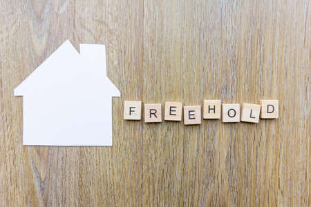 The word freehold beside paper in the shape of a house