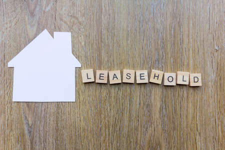 The word leasehold beside paper in the shape of a house
