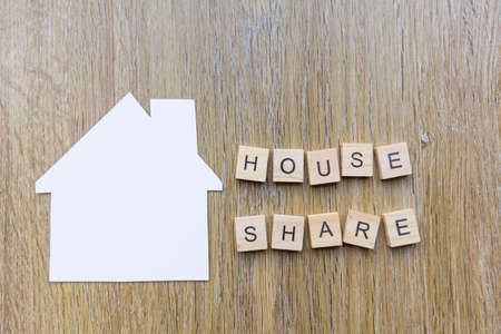 House Share concept - paper house with the word house share Фото со стока