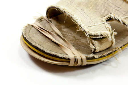 Sole of shoe with a temporary repair - rubber band holding together sole of shoe Imagens