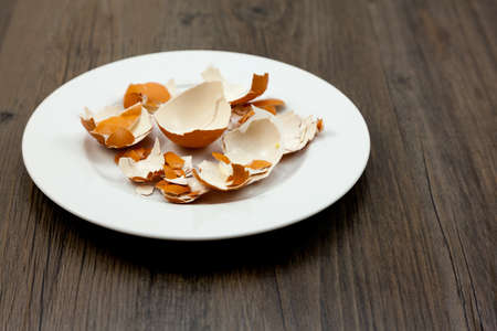 Plate of broken and peeled eggshells