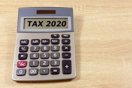 Budgeting for the year concept with calculator - stating the year 2020